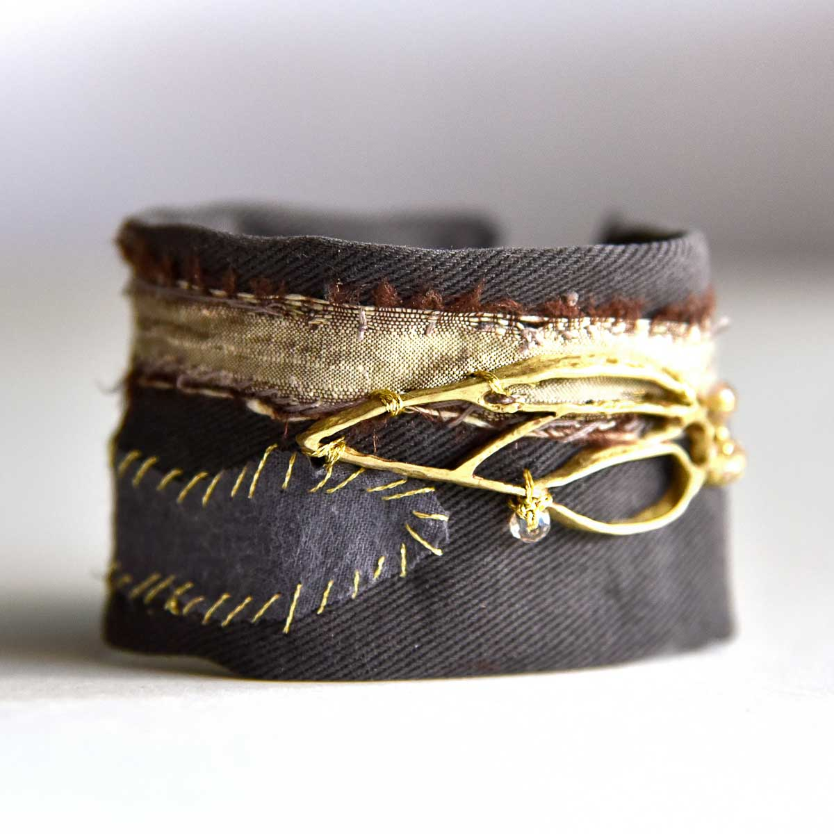 Bracelet with bronze handmade charm and recycled fabric. Made for Bead A Boo Jewelry by Katerina Glinou.