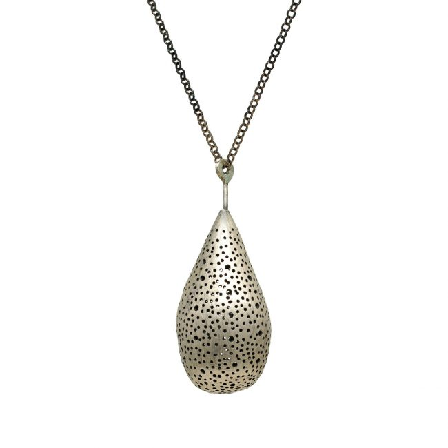 "The ""Large Drop"" necklace is part of the Experimental jewelry collection. It is a large hollow silver drop charm with tiny holes, made for a necklace."