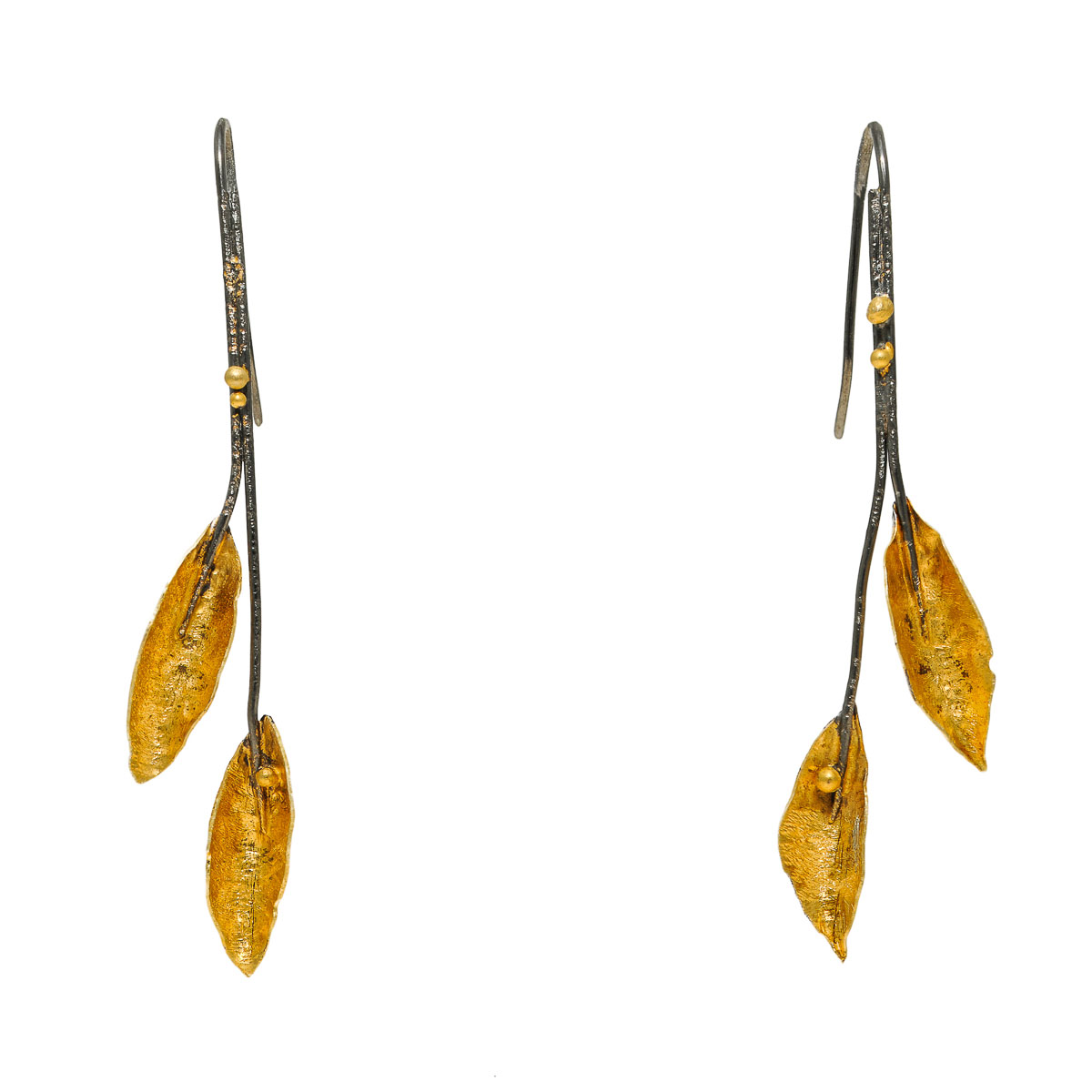 """""""Leaves"""" project is part of the """"Imaginary Nature"""" jewelry collection. They are available in silver and a variety of designs and sizes from tiny to large."""