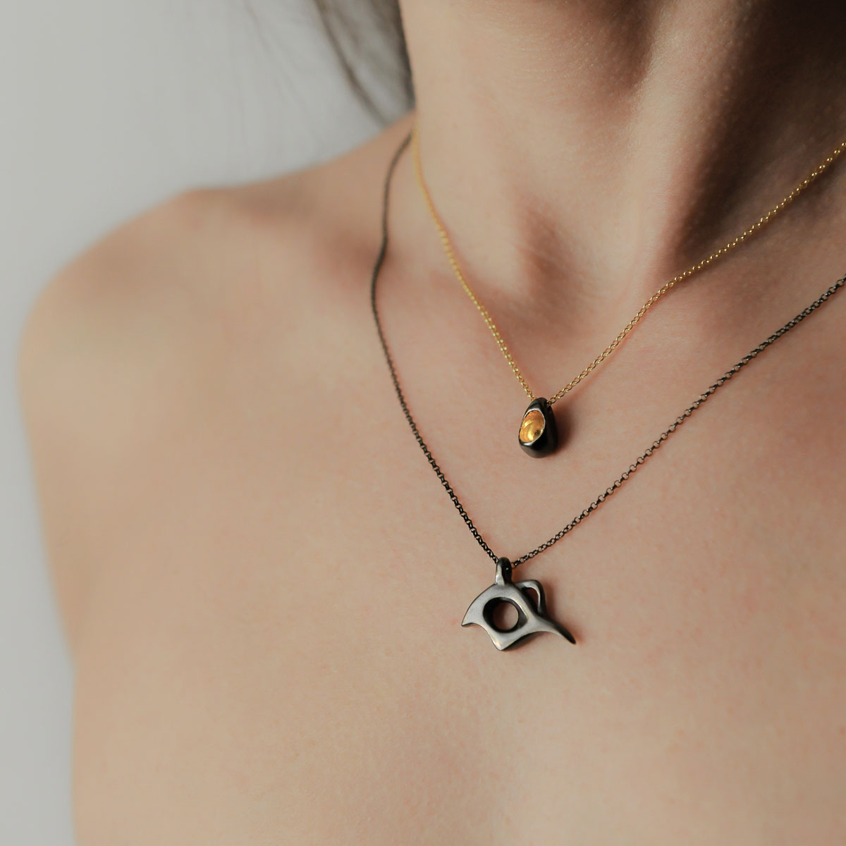 """""""Seeds and Pits"""" necklace in gold plated silver and """"Bird of Paradise"""" necklace in black rhodium. Design and handmade for Bead A Boo jewelry by Katerina Glinou."""