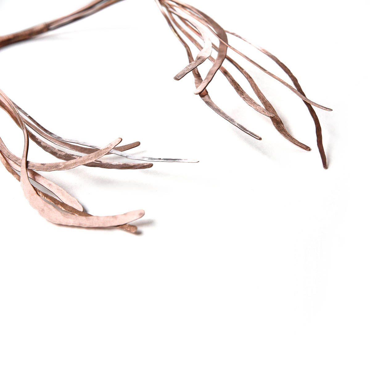 The Seaweed Collection is part of the Experimental jewelry works. These jewelry pieces are made from hammered copper wires to show the movement of seaweed.