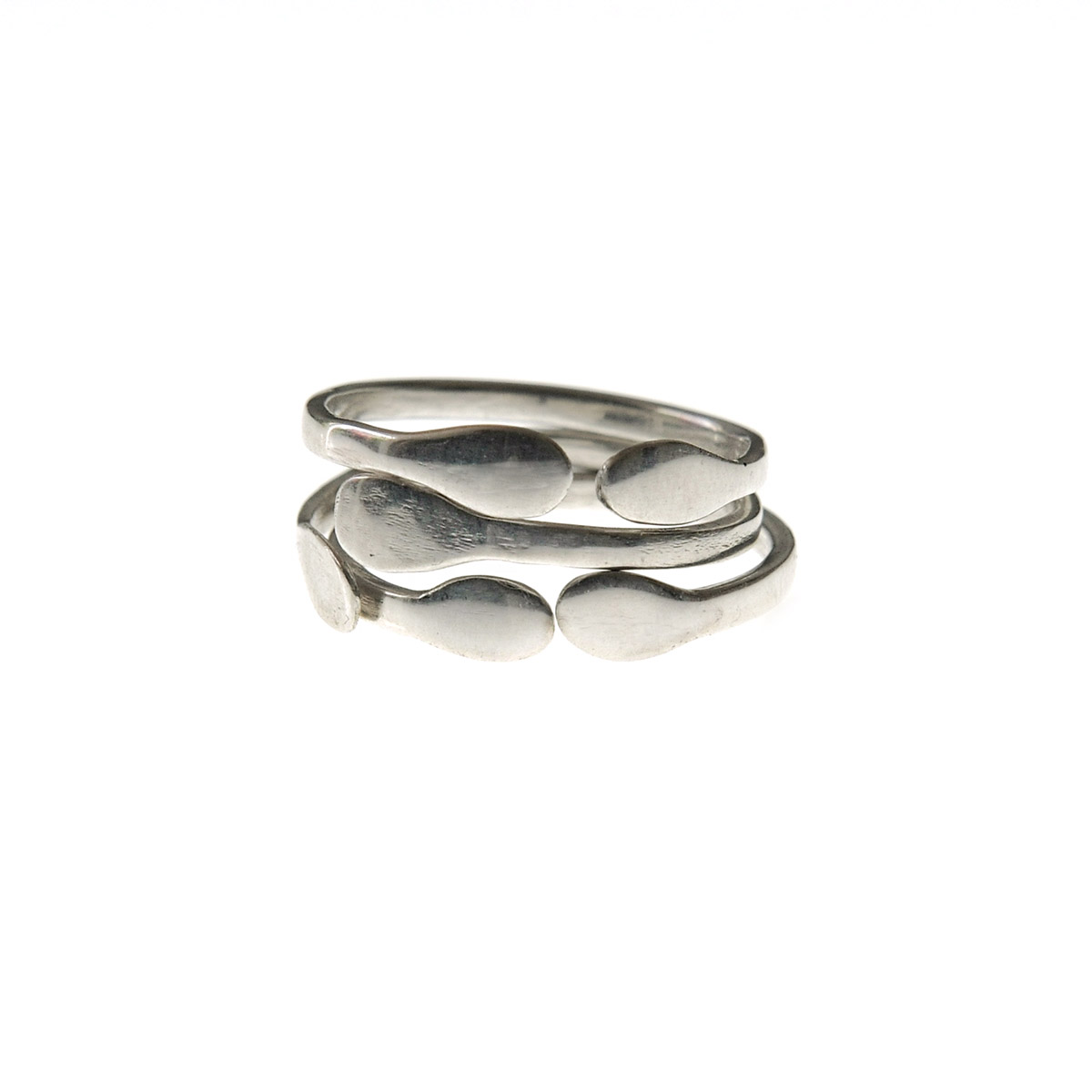 "The ""Circle"" design is part of the ""Symbols"" jewelry collection. The ""Circle"" jewelry is available in hammered sterling silver, in polished or matte finish."