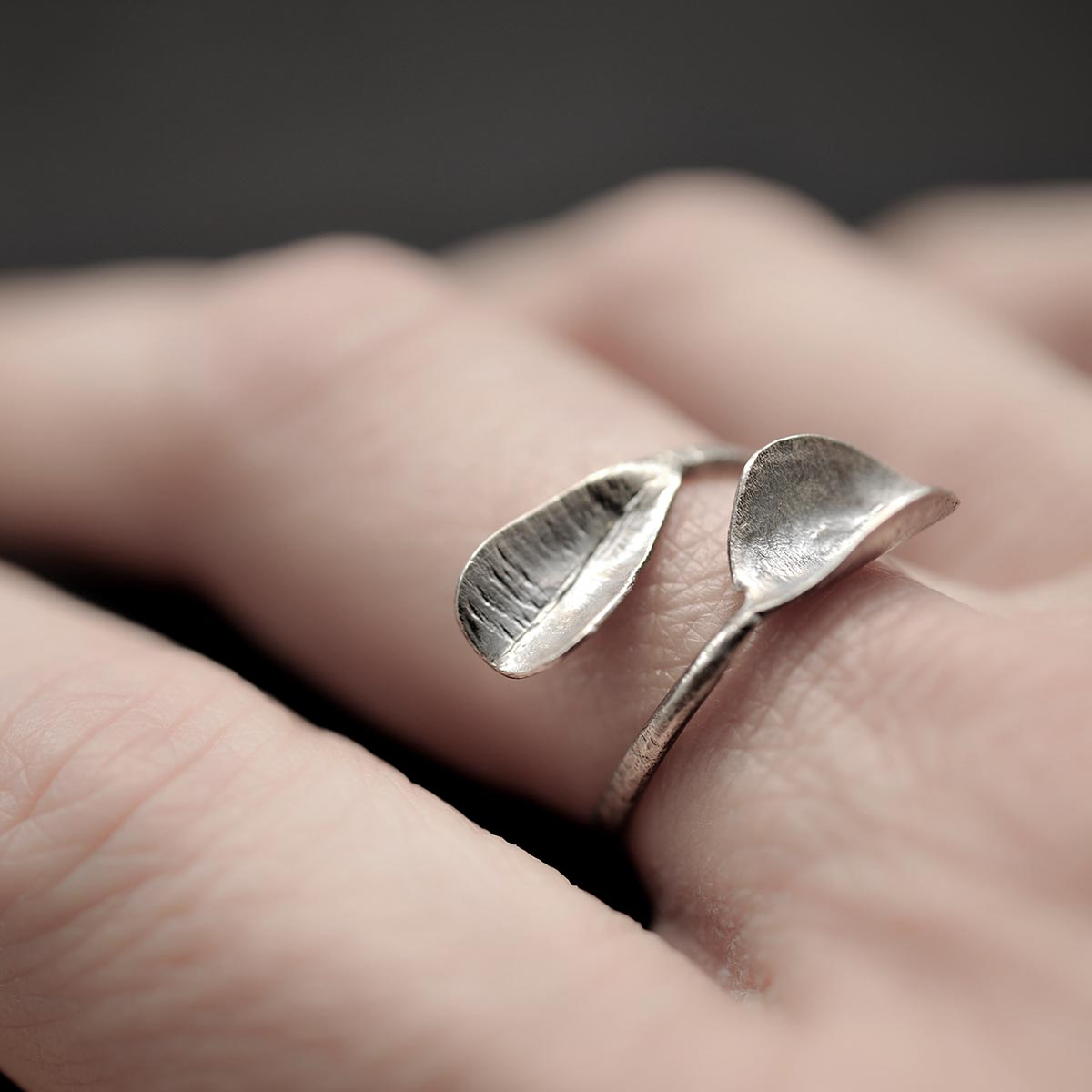 Hammered silver open ring. Edges formed as leaves. Design and handmade for Bead A Boo jewelry by Katerina Glinou.