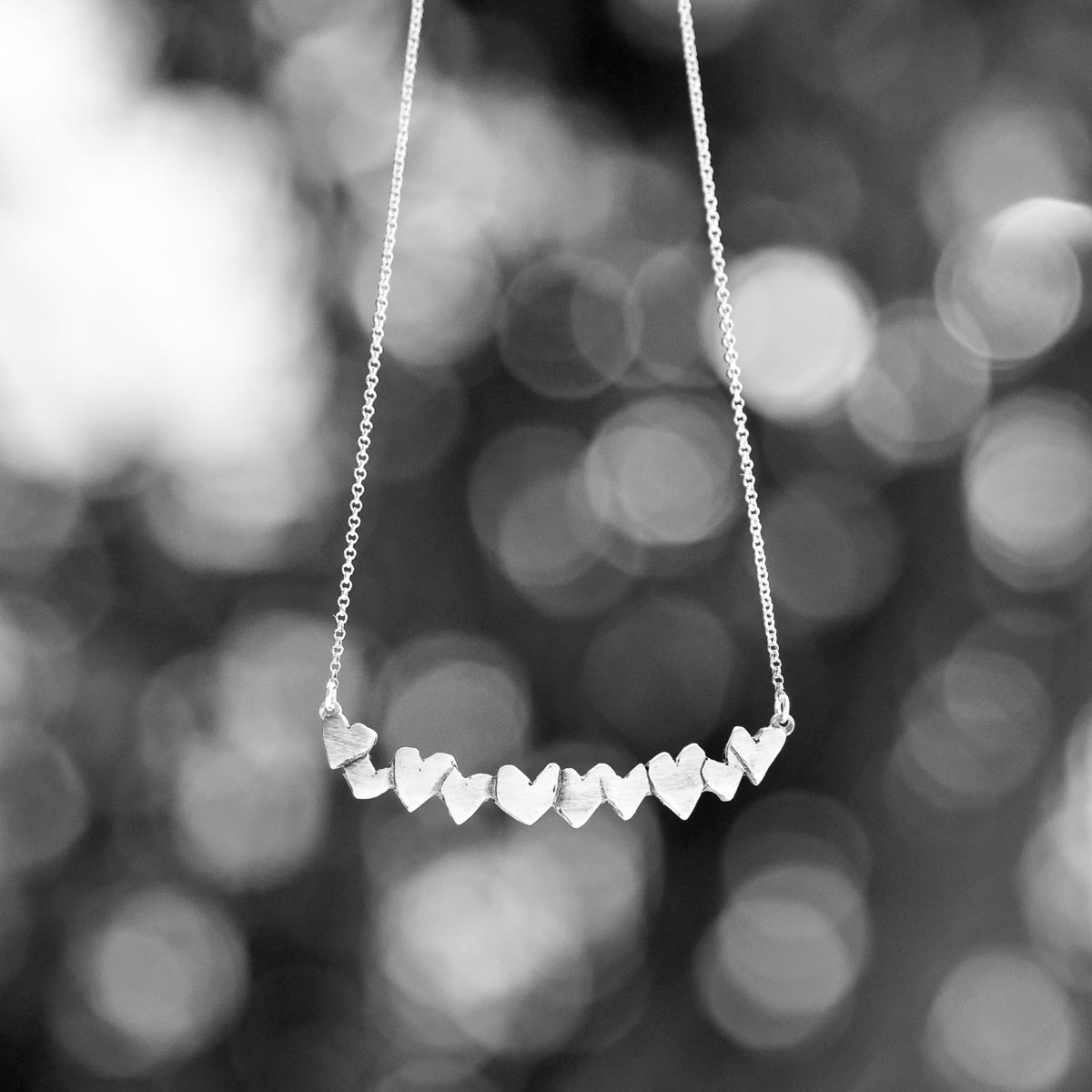 """Hearts is part of the """"Symbols"""" jewelry collection. Hearts jewelry piece is available in sterling silver. Design for Bead A Boo jewelry by Katerina Glinou."""