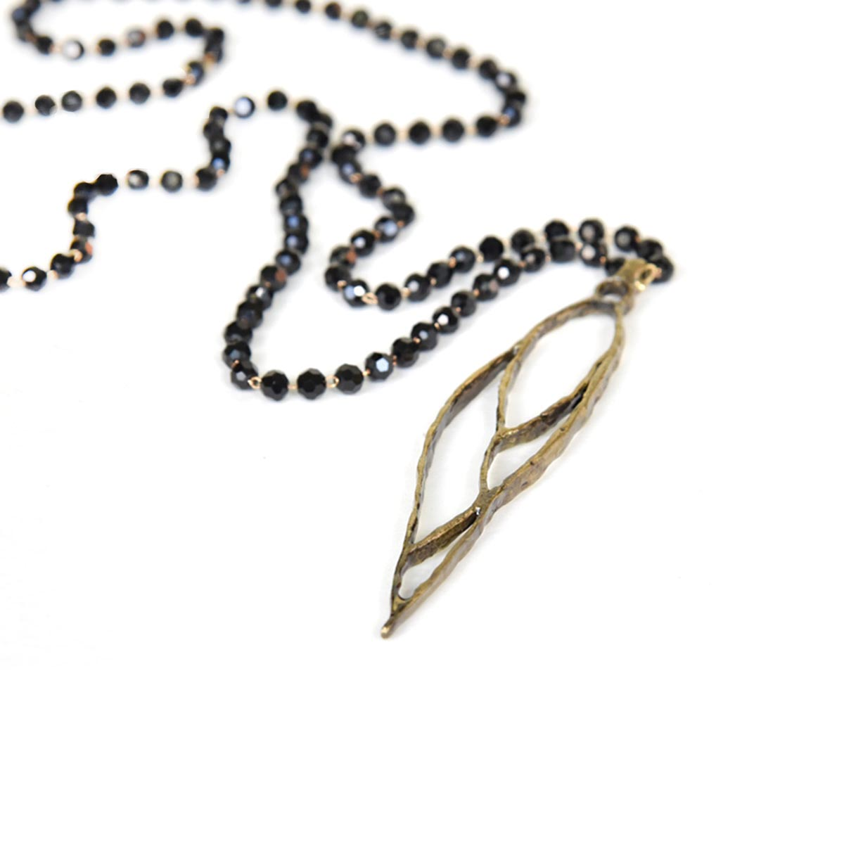 Leaves long pendant in bronze. Design and handmade for Bead A Boo jewelry by Katerina Glinou.