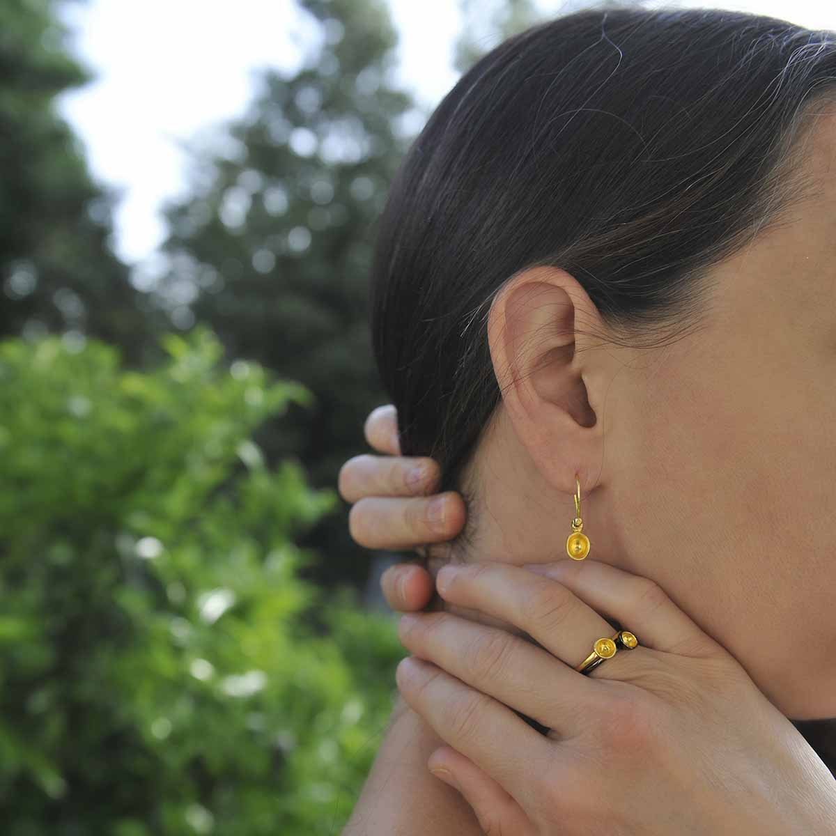 """""""Seeds and Pits"""" earrings in gold plated sterling silver and """"Dots"""" gold rings. Design and handmade for Bead A Boo jewelry by Katerina Glinou."""