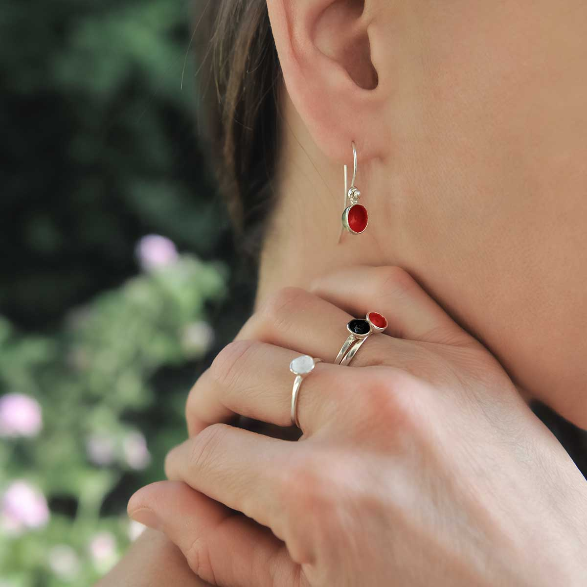 """""""Seeds and Pits"""" earrings in sterling silver, colored with enamel paint, match with """"Dots"""" rings. Design and handmade for Bead A Boo jewelry by Katerina Glinou."""